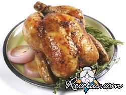 Pollo asado con limón y cebolla sobre arroz